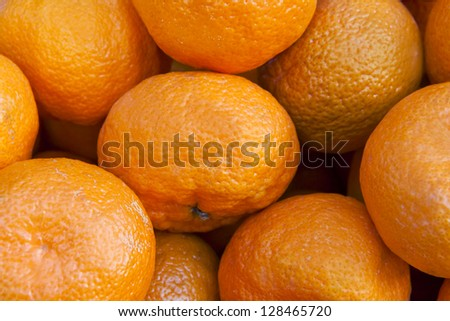 Bunch of fresh mandarin oranges on market - stock photo