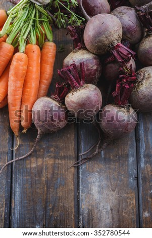 Bunch of fresh organic beetroots and carrots - stock photo