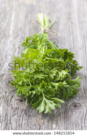 Bunch of fresh parsley on wooden table