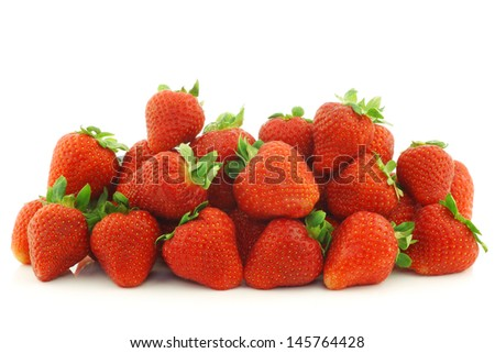 bunch of fresh strawberries on a white background - stock photo