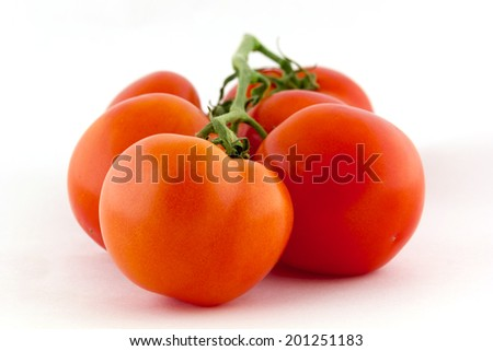 Bunch of fresh tomatoes. Isolated on white background.