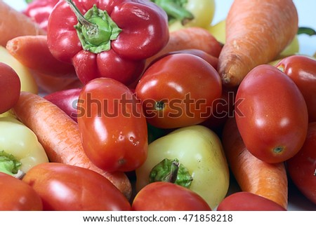 bunch of fresh tomatoes pepper carrots as a vegetable crop