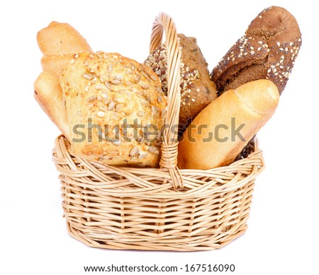 Bunch of Freshly Baked Various Bread in Wicker Basket isolated on white background - stock photo