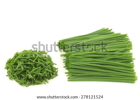 Bunch of freshly cut green chive on white background - stock photo