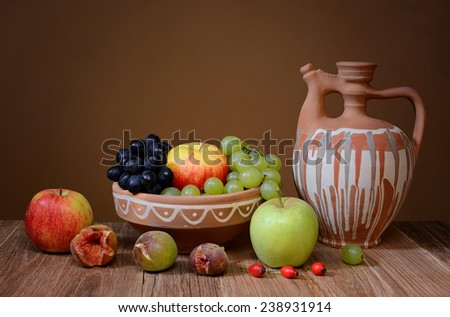 Bunch of fruits on a wooden table - stock photo