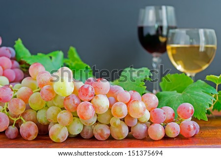 bunch of grape and glasses of white and red wine - stock photo