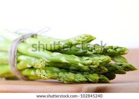 Bunch of green asparagus on white background - stock photo