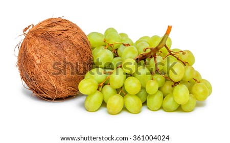 Bunch of green grapes and coconut isolated on white background - stock photo