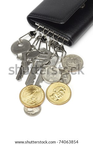 Bunch of keys and US coins on white background