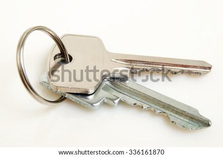 Bunch of keys on a light background. - stock photo