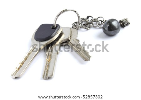 Bunch of keys with metal chain and hematite stone isolated on white background