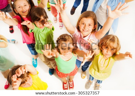 Bunch of kids lifting hands in the air