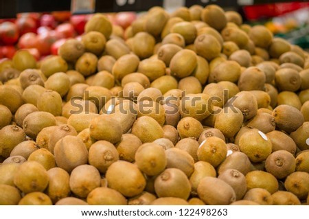 Bunch of kiwi fruits in supermarket