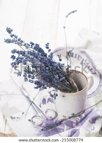 Bunch of lavender flowers in cup, selective focus  - stock photo