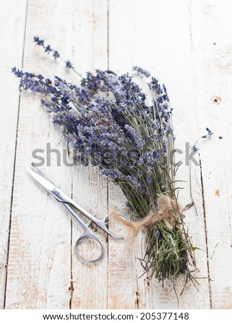 Bunch of lavender flowers on table, selective focus