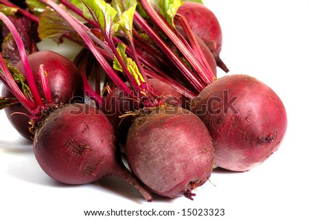 bunch of  leafy fresh beets isolated on white - stock photo