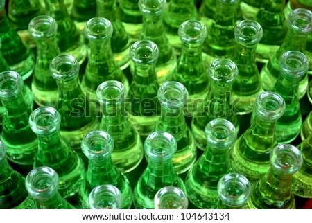 Bunch of little  glass bottles - stock photo