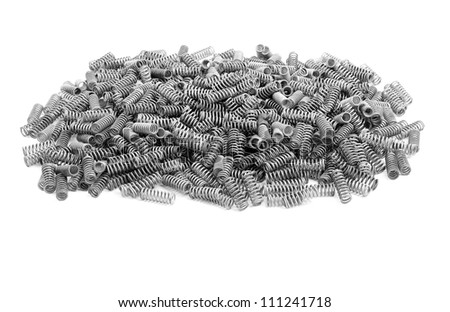 bunch of little metal springs on white - stock photo