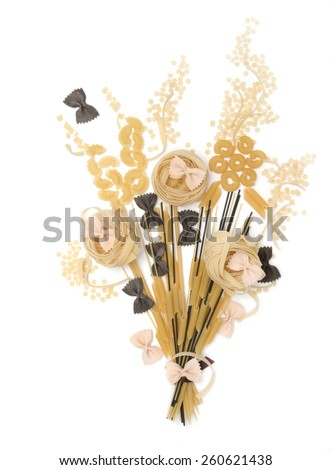 bunch of macaroni, spaghetti, pasta of various kinds, tagliatelle, colorful farfalle with cuttlefish ink and salmon on a white background, top view - stock photo