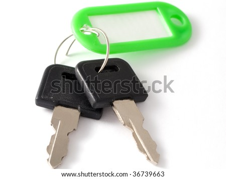 Bunch of metal house key on ring isolated on white