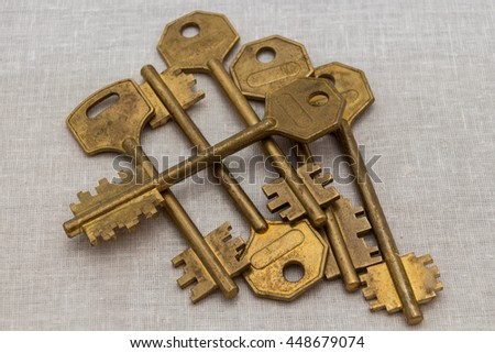 Bunch of metal keys on white background