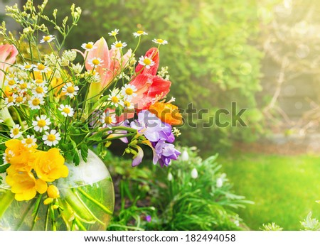 bunch of mix summer flowers with daisies, lilies, freesia  in sunny garden  - stock photo