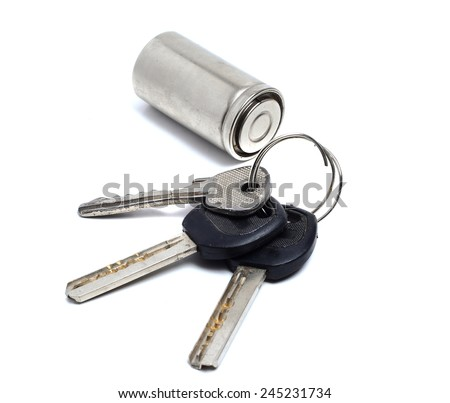 bunch of old keys and battery on a white - stock photo