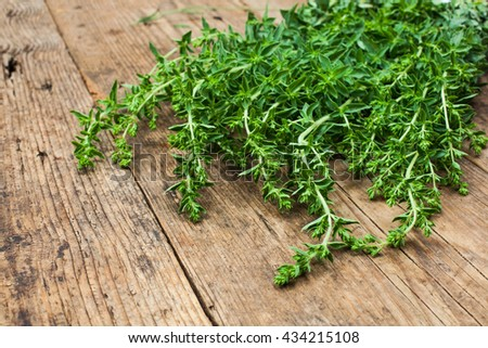 bunch of oregano on a wooden background