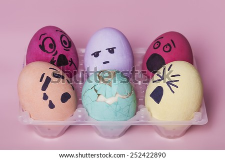 Bunch of painted eggs reacting to dead broken egg - stock photo
