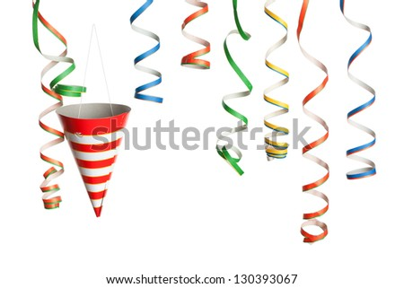 Bunch of party streamers and hat hanging in the air. Photographed in studio isolated on white background.
