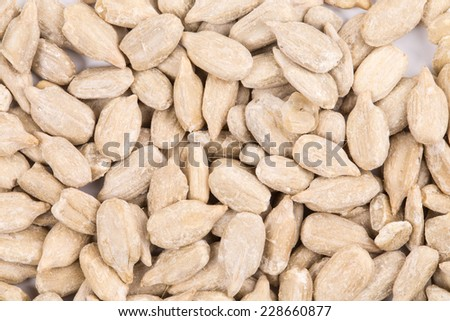 Bunch of pelled sunflower seeds. Isolated as a background.