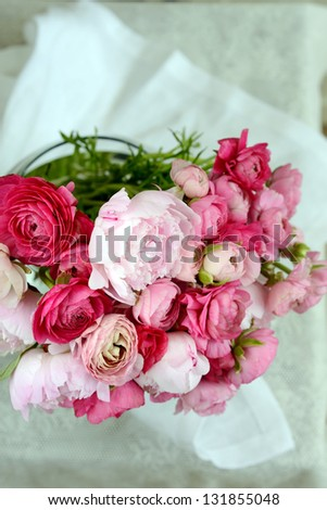 bunch of pink ranunculus  and peonies