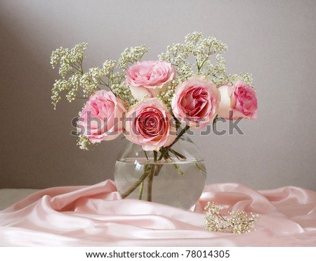 Bunch of pink roses in vase - stock photo