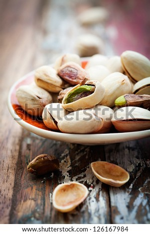 Bunch of pistachios with very selective focus - stock photo
