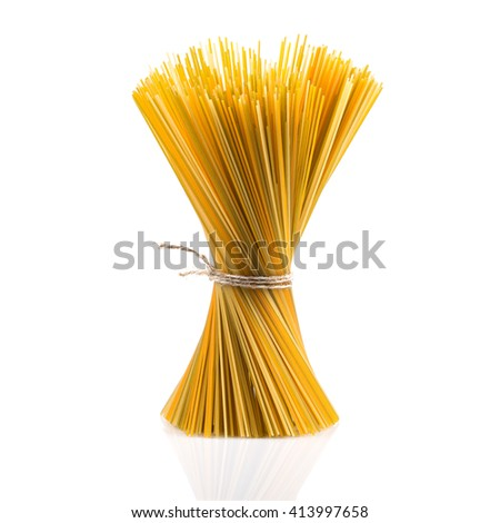 Bunch of raw italian pasta with vegetable dye of spinach, paprika and carrot - stock photo