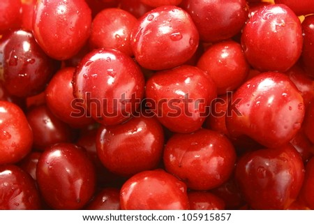 bunch of red cherry without the stem attached