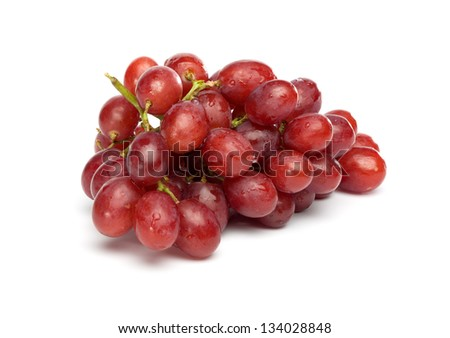 Bunch of red grapes , fresh with water drops. Isolated on white background. - stock photo
