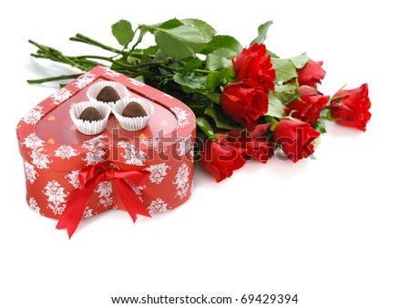 bunch of red roses and  heart-shaped gift with chocolate for St.Valentine's Day - stock photo