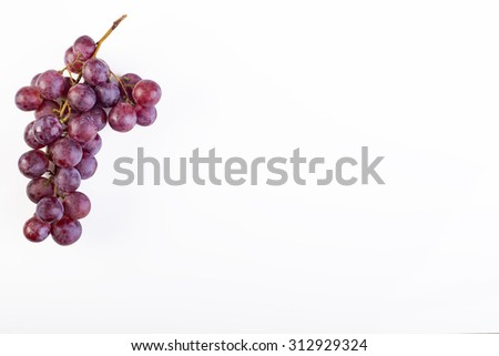 Bunch of ripe and juicy red grapes on a white background - stock photo