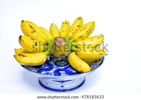 Bunch of ripe bananas on white background