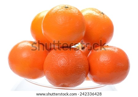 Bunch of ripe orange tangerines on a white background - stock photo