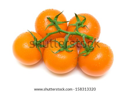 bunch of ripe tomatoes orange in water drops on a white background. top view - horizontal photo. - stock photo