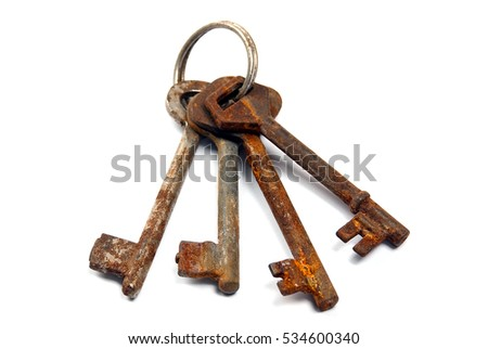 bunch of rusty keys. Isolated on white background