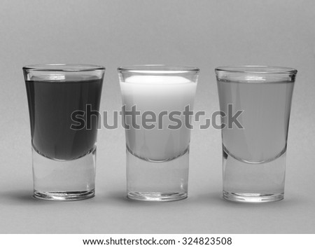 Bunch of shots, filled with water, apple juice, wine, sparkling and milk - stock photo