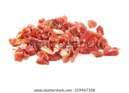Bunch of sliced spanish serrano ham on a white background - stock photo