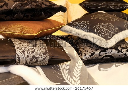 Bunch of soft decorative pillows at bed - stock photo