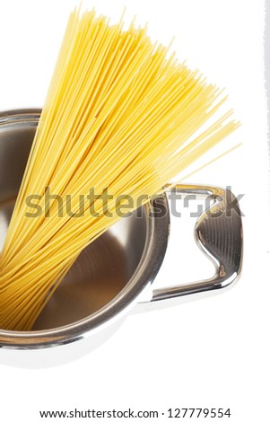 Bunch of spaghetti in a pot isolated over white background - stock photo