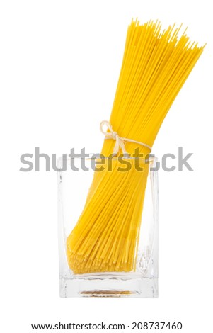 Bunch of spaghetti in transparent vase isolated on white background - stock photo