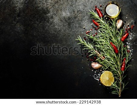 Bunch of spices on dark vintage background. Cooking, vegetarian food or health concept. - stock photo