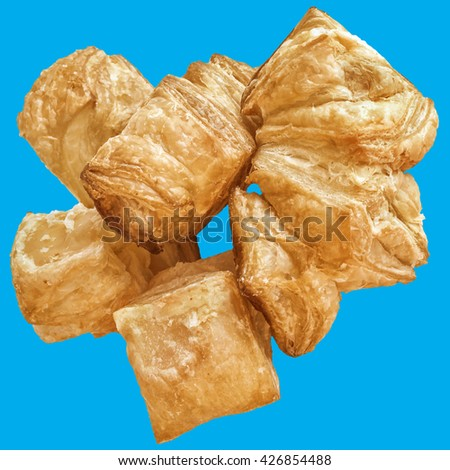 Bunch of square Sesame croissant puff pastry, isolated on Blue background. - stock photo
